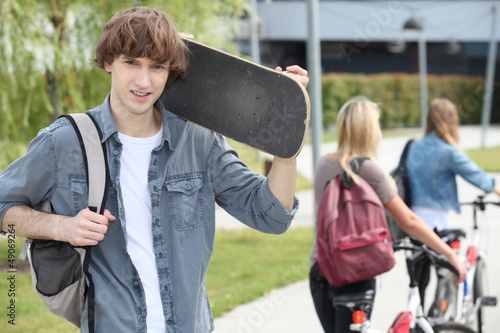 Student on campus with a skateboard