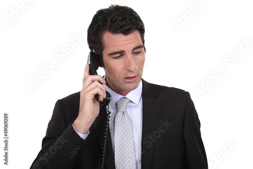 Businessman making important call
