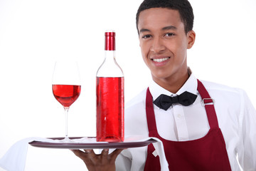 Male waiter with wine on tray