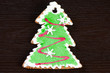 Gingerbread Christmas tree on a dark wooden background