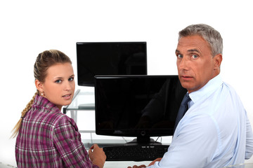 teacher and student in front of computer