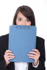 Surprised woman with an office clipboard
