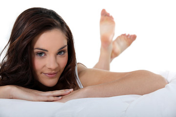 beautiful woman lying in her bed