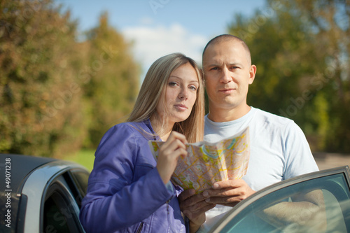 tourist couple looking at the map