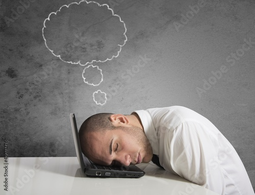 Businessman dreams while sleeping