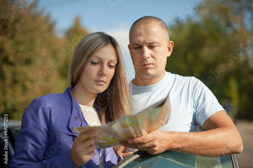 Traveler couple looking at the map