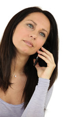 Brunette using her mobile telephone