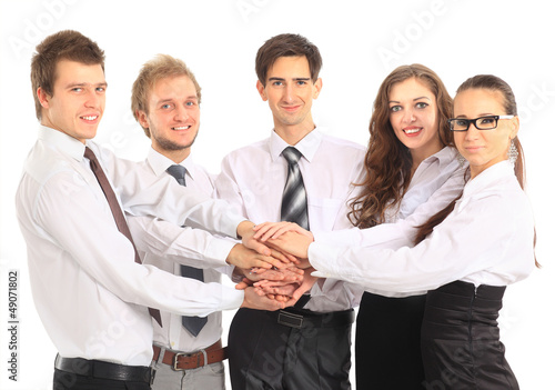 business team putting their hands on top of each