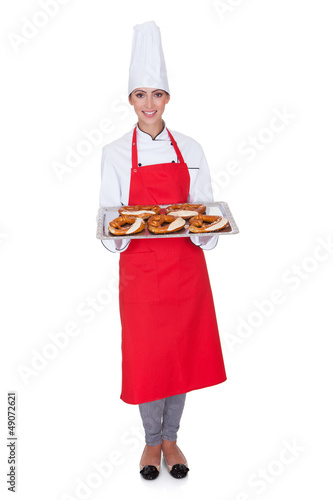 Female Baker Holding Fresh Bavarian Pretzel