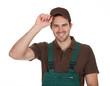Happy young gardener in dungarees