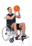 Man in wheelchair playing basketball