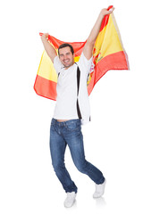 Portrait Of A Happy Man Holding An Spanish Flag