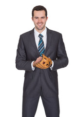 Competitive businessman with baseball glove