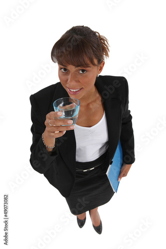 Businesswoman drinking a glass of water