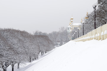 Snowy landscape with orthodox monastery in Kharkov Ukraine
