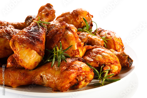 Grilled chicken legs on white background