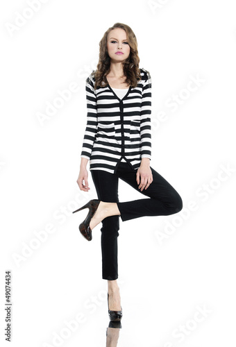 Pretty young woman in stripy t-shirt and jeans posing
