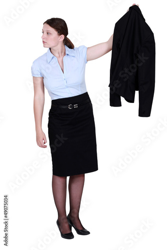A businesswoman presenting her jacket.