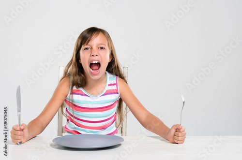 Rude screaming child at dinner table bad manners