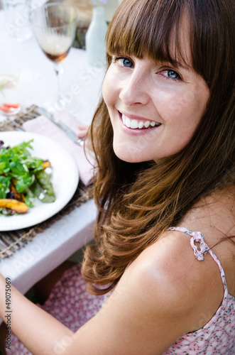 Beautiful woman with healthy green salad