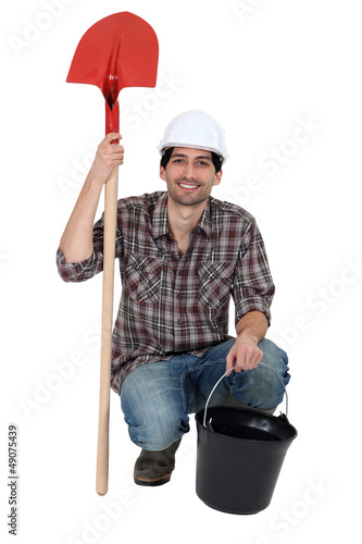 craftsman holding a shovel and a bucket