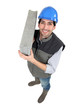 Man carrying breeze block