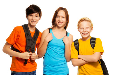 Three kids with school backpacks