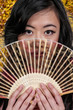 Woman with an Asian fan