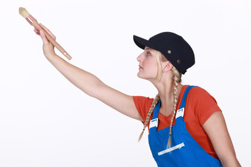 Handywoman painting on white background