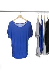 Blue female clothing set of hanging on hangers