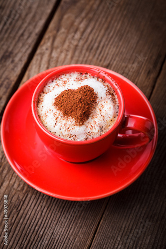 Red cup with cappuccino