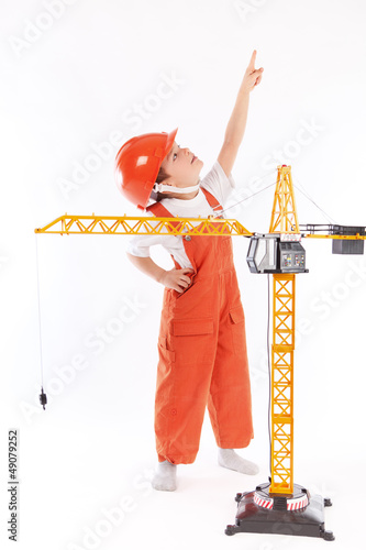 Small builder and crane on white background