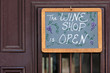Open sign on wine shop door in St Augustine, Florida
