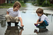 two boy play in water
