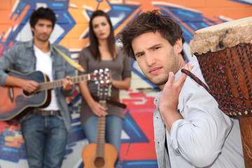 Young people with guitars and drums