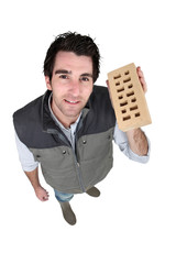 craftsman holding a brick