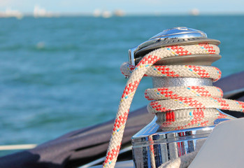 Sailing boat winch with red rope closeup
