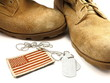 Desert boots, camouflage American Flag patch and dog tags