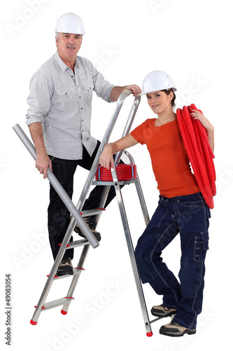 Two electrician installing wiring