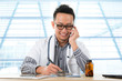 Asian medical doctor working on desk