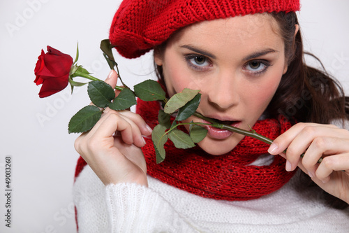 Brunette with rose in her mouth