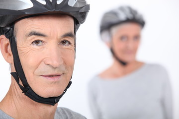 Senior man with a bicycle helmet