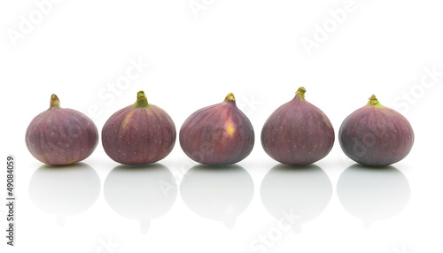 ripe figs on white background