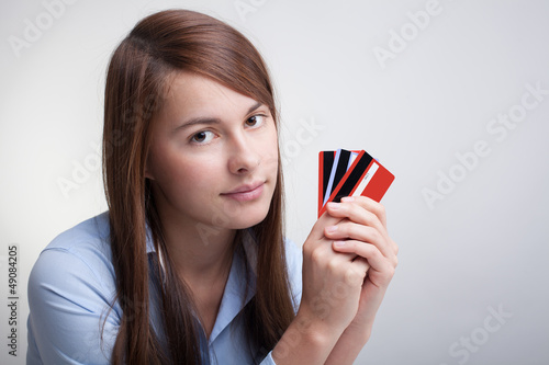 Young woman with credit cards