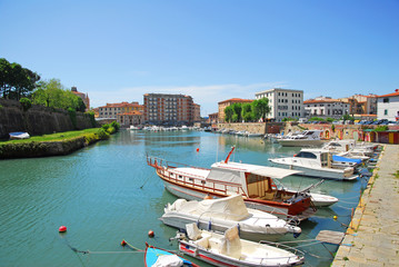 Italy, downtown Livorno, boats at Venice district
