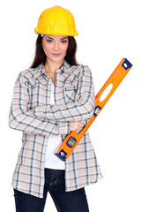 pretty female carpenter posing with ruler