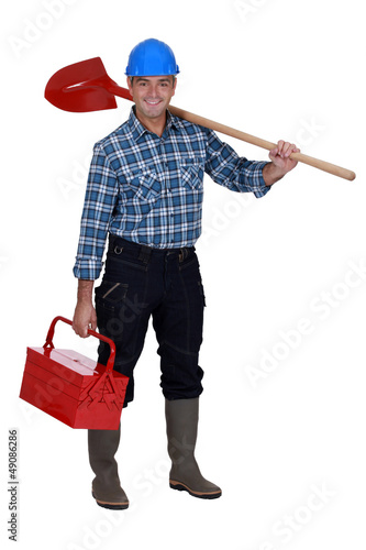Mason carrying spade and tool kit