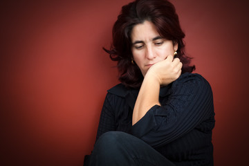 Beautiful hispanic woman with a very sad expression
