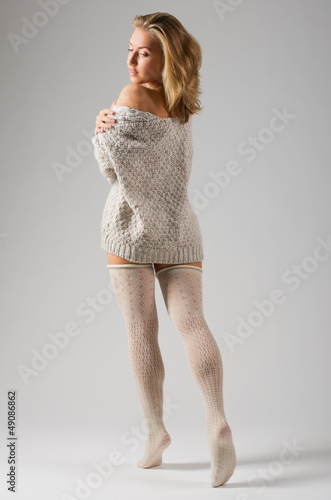 Fashion stye portrait of young girl on grey