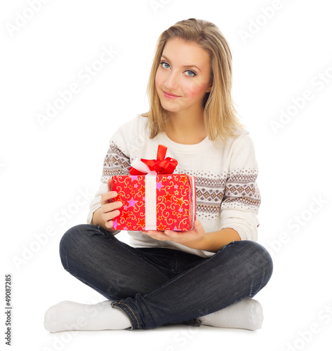Young girl sit on the floor with gift box